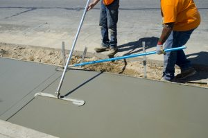 Workers laying concrete for a foundation in Tampa